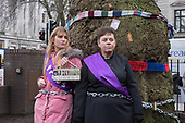 Local resident Jo Hurtfurd and Rev'd Anne Stevens, Vicar of St Pancras, chained to one of more than 200 mature trees before felling begins to make way for HS2 construction trucks at Euston station, London.