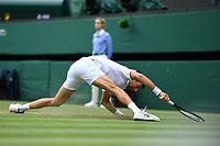 11th July 2021, Wimbledon SW London England, AELTC Wimbledon Tennis Championships, mens final, Novak Djokovic (Ser)  versus Matteo Berrettini (Ita), Novak Djokovic (Ser) slips as he returns
