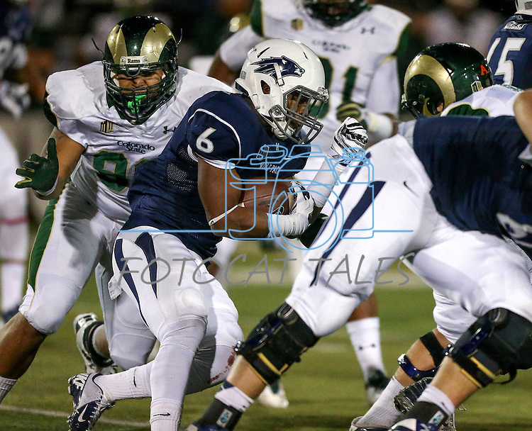 Nevada's Don Jackson (6) runs up the middle against Colorado State defenders Josh Lovingood (92) and Johnny Schupp (98) during the first half of an NCAA college football game in Reno, Nev., on Saturday, Oct. 11, 2014. (AP Photo/Cathleen Allison)