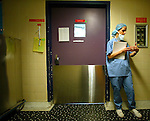 NOT MODEL RELEASED; FOR EDITORIAL USE ONLY... surgical nurse waiting to enter an operating room