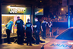 © Joel Goodman - 07973 332324. 26/09/2017. Brighton, UK. Police detain , handcuff , tape up the legs and put a hood over the head of a man outside a branch of Subway , after a fight in Steine Gardens in the Kemptown area of the city . Revellers at the end of a night out in Brighton during Freshers week , when university students traditionally enjoy the bars and clubs during their first nights out in a new city . Photo credit : Joel Goodman
