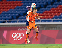 YOKOHAMA, JAPAN - JULY 30: Megan Rapinoe #15 of the USWNT goes up for a header with Lynn Wilms #2 of the Netherlands during a game between Netherlands and USWNT at International Stadium Yokohama on July 30, 2021 in Yokohama, Japan.