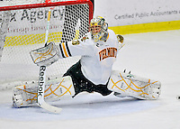 2 December 2011: University of Vermont Catamount goaltender Rob Madore, a Senior from Pittsburgh, PA, does the splis in the third period against the University of Maine Black Bears at Gutterson Fieldhouse in Burlington, Vermont. The Catamounts fell to the Black Bears 6-4 in the first game of their 2-game Hockey East weekend series. Mandatory Credit: Ed Wolfstein Photo