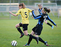 20140502 - VARSENARE , BELGIUM : Brugge's Lore Dezeure (right) pictured with Lierse's Chloe Van Mingeroet (left)  during the soccer match between the women teams of Club Brugge Vrouwen  and WD Lierse SK  , on the 26th matchday of the BeNeleague competition on Friday 2 May 2014 in Varsenare .  PHOTO DAVID CATRY