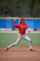 Philadelphia Phillies shortstop Bryson Stott (10) throws to first base after losing his glove on the play during an Instructional League game against the Toronto Blue Jays on September 27, 2019 at Englebert Complex in Dunedin, Florida.  (Mike Janes/Four Seam Images)