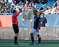 Foxborough, Massachusetts - March 9, 2019:  In a Major League Soccer (MLS) match, Columbus  Crew (yellow) defeated New England Revolution (blue/white), 2-0, at Gillette Stadium.<br /> David Gantar issues red card to Brandon Bye, which was changed to a yellow card after consulting VAR.