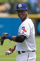 Round Rock Express shortstop Jurickson Profar #10 warms up before the Pacific Coast League baseball game against New Orleans Zephyrs on April 21, 2013 at the Dell Diamond in Round Rock, Texas. Profar, the Texas Rangers top prospect, slugged a grand slam home run in the seventh inning leading Round Rock to a 7-1 win over New Orleans. (Andrew Woolley/Four Seam Images).