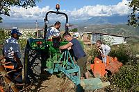 ALBANIA, Berat , farmer Agim Metka and son Engiell with new John Deere Tractor  / ALBANIEN, Berat, Landwirt Agim Metka and Sohn Engiell mit neuem John Deere Traktor