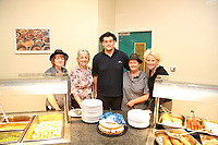 Pictured L-R: Lotto winners colleagues Andrea Davies, Sue Jones, Nick Mak, Clare Birchall and director of services Clare Edwards at Neath Port Talbot hospital. Wednesday 08 November 2017<br /> Re: Presentation of hospital catering syndicate win £25m in Euromillions Jackpot at Hensol Castle, south Wales, UK. Julie Saunders, 56, Doreen Thompson, 56, Louise Ward, 37, Jean Cairns, 73, SIan Jones, 54 and Julie Amphlett, 50 all work as catering staff for Neath Port Talbot Hospital in south Wales.