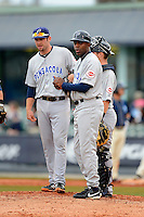 Pensacola Blue Wahoos manager Delino Deshields #90 makes a pitching change as first baseman Travis Mattair and catcher Tucker Barnhart wait during a game against the Mobile BayBears on April 14, 2013 at Hank Aaron Stadium in Mobile, Alabama.  Mobile defeated Pensacola 5-2.  (Mike Janes/Four Seam Images)