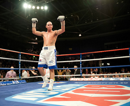 GLASGOW, SCOTLAND - MARCH 10: Stephen Simmons (white and blue shorts) defeats Hastings Rasani in a Cruiserweight contest on the Ricky Burns undercard at the Braehead Arena on March 10, 2012 in Glasgow, Scotland. (Photo by Rob Casey/Getty Images)