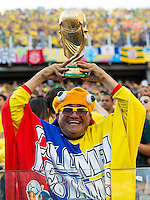 A Columbia fan holds a fake trophy above his head