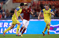 Calcio, Serie A: Roma vs ChievoVerona. Roma, stadio Olimpico, 18 ottobre 2014.<br /> Roma's Adem Ljajic, center, is challenged by Chievo Verona's Dario Dainelli, left, and Nicolas Frey, during the Italian Serie A football match between Roma and ChievoVerona at Rome's Olympic stadium, 18 October 2014.<br /> UPDATE IMAGES PRESS/Isabella Bonotto