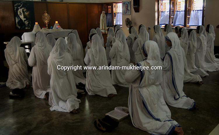 Nuns (Sisters) of Missionaries of Charity(Which was founded by Mother Teresa) during prayer at Mother's House, Kolkata, West Bengal, India. 18th August 2010. Arindam Mukherjee