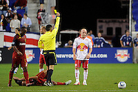 Luke Rodgers (9) of the New York Red Bulls gets a yellow card from referee Jorge Gonzalez. Real Salt Lake defeated the New York Red Bulls 3-1 during a Major League Soccer (MLS) match at Red Bull Arena in Harrison, NJ, on September 21, 2011.