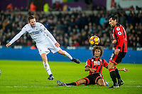 Gylfi Sigurdsson of Swansea City  strikes the ball during the Premier League match between Swansea City and Bournemouth at The Liberty Stadium, Swansea, Wales, UK. Saturday 31 December 2016