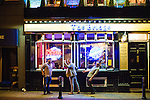 © Joel Goodman - 07973 332324 . 11/09/2016 . Manchester , UK . A man staggers backwards outside The Bridge on Bridge Street . Revellers out in Manchester City Centre . Photo credit : Joel Goodman