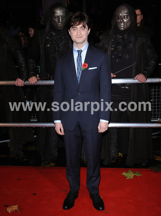 **ALL ROUND PICTURES FROM SOLARPIX.COM**                                             **WORLDWIDE SYNDICATION RIGHTS**                                                                                  Red carpet arrivals at the World Premiere of Harry Potter and The Deathly Gallows.  Held at the Odeon Leicester Square and Empire Leicester Square in London, on Thursday November 11, 2010.                                                                            This pic:    Daniel Radcliffe                                                                                     JOB REF:     12464   SSD       DATE:      11.11.10                                                      **MUST CREDIT SOLARPIX.COM OR DOUBLE FEE WILL BE CHARGED**                                                                      **MUST AGREE FEE BEFORE ONLINE USAGE**                               **CALL US ON: +34 952 811 768 or LOW RATE FROM UK 0844 617 7637**