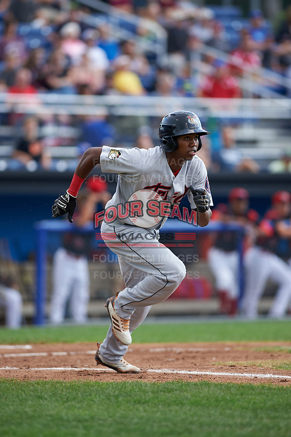 Tri-City ValleyCats center fielder Andy Pineda (12) runs to first base during a game against the Batavia Muckdogs on July 14, 2017 at Dwyer Stadium in Batavia, New York.  Batavia defeated Tri-City 8-4.  (Mike Janes/Four Seam Images)