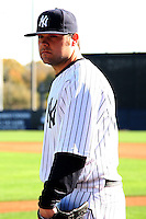 February 25, 2010:  Pitcher Joba Chamberlain of the New York Yankees listens to instruction from a photographer during photo day at Legends Field in Tampa, FL.  Photo By Mike Janes/Four Seam Images