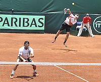 CALI – COLOMBIA – 05-04-2014: Victor Estrella y Jose Hernandez de Republica Dominicana en accion contra Juan Sebastian Cabal y Robert Farah de Colombia durante el dia dos de partidos en el Grupo I de la Zona Americana de la Copa Davis, partidos entre Colombia y República Dominicana en Estadio de Tenis Alvaro Carlos Jordan en la ciudad de Cali. / Victor Estrella and Jose Hernandez of the Dominican Republic in action against Juan Sebastian Cabal and Robert Farah of Colombia during day two in matches for the Group I of the American Zone Davis Cup, between Colombia and the Dominican Republic, at the Carlos Alvaro Jordan, Tennis  Stadium in the city of Cali. Photo: VizzorImage / Luis Ramirez / Staff.