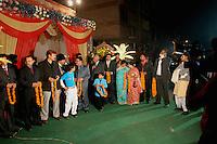 07.12.2008 Delhi(Haryana)<br /> <br /> Family members of the bride waiting for the groom arrival with flowers garlands.<br /> <br /> Membres de la famille de la mariée attendant l'arrivée du marié avec des guirlandes de fleurs.