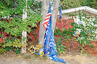 American and Trump campaign flags stand against trees before Donald Trump, Jr., son of president Donald Trump and a rising Republican political star, speaks at an outdoor campaign rally at The Lobster Trap in North Conway, New Hampshire, on Thu., Sept. 24, 2020.