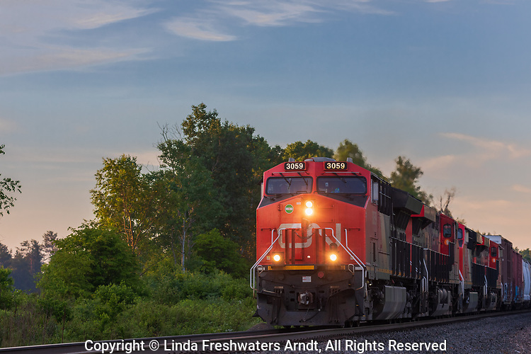 Freight train traveling through a rural community in northern Wisconsin.