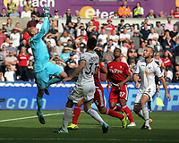 Heurelho Gomes of Watford (L) grabs the ball during the Premier League match between Swansea City and Watford at The Liberty Stadium, Swansea, Wales, UK. Saturday 23 September 2017