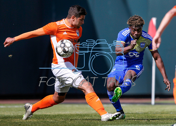 Reno 1868 midfielder Christiano Fracois shoots past a San Diego Loyal SC defender during a preseason match in Reno, Nev., on Saturday, Feb. 29, 2020. San Diego won 4-2. <br />Photo by Cathleen Allison/Cathleen Allison Photography