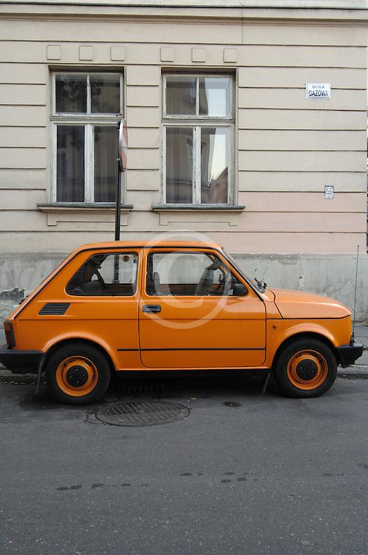 Poland, Krakow, Yellow parked car