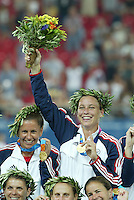 26 August 2004: Abby Wambach with her gold medal during the ceremony after defeating Brazil, 2-1 at Karaiskakis Stadium in Athens, Greece.  Credit: Michael Pimentel / ISI.