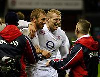 Photo: Richard Lane/Richard Lane Photography. England v New Zealand. QBE Autumn Internationals. 01/12/2012. England's Chris Robshaw and James Haskell celebrate victory.