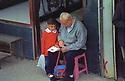 Turkey 2005 A little boy with his grandfather in the street of Dogubayazit  Turquie 2005  Grand-pere et petit-fils dans une rue de Dogubayazit