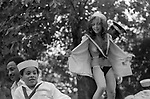Notting Hill Carnival London 1981. 1980s UK Notting Hill Carnival London 1980s Topless young woman on a float going around the streets getting carried away showing off, being provocative wanting to be the centre of attention and to be noticed. 1981 UK