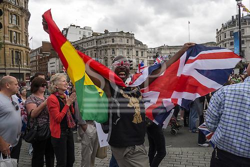 Trafalgar Square, London, Engand. A British supporter with Union Jack sunglasses.