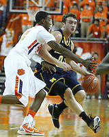 Nov 30, 2010; Clemson, SC, USA; Michigan Wolverines guard Zack Novak (0) dribbles around Clemson guard Demontez Stitt (2) in the game against the Clemson Tigers at Littlejohn Coliseum. Mandatory Credit: Daniel Shirey/WM Photo -US PRESSWIRE