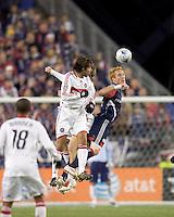 Chicago Fire midfielder Baggio Husidic (9) and New England Revolution midfielder/defender Jeff Larentowicz (13) battle for head ball. The New England Revolution tied the Chicago Fire, 0-0, at Gillette Stadium on October 17, 2009.
