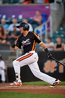Aberdeen IronBirds catcher Alfredo Gonzalez (19) follows through on a swing during a game against the Staten Island Yankees on August 23, 2018 at Leidos Field at Ripken Stadium in Aberdeen, Maryland.  Aberdeen defeated Staten Island 6-2.  (Mike Janes/Four Seam Images)