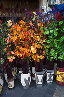 Yogyakarta, Java, Indonesia.  Artificial Flowers and Leaves for sale, Malioboro Street.