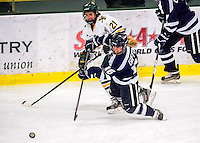2 February 2013: University of Vermont Catamount forward Amanda Pelkey, a Sophomore from Montpelier, VT, battles forward Nicole Gifford, a Junior from Ennismore, Ontario, of the University of New Hampshire Wildcats at Gutterson Fieldhouse in Burlington, Vermont. The Lady Wildcats defeated the Lady Catamounts 4-2 in Hockey East play. Mandatory Credit: Ed Wolfstein Photo