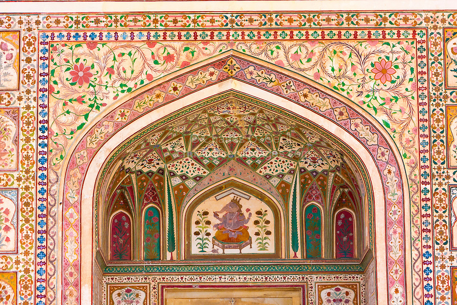 Jaipur, Rajasthan, India.  Hindu God Ganesh and Floral Decoration above the  Ganesh Pol, the Entrance to the Maharaja's Private Quarters, Amber (or Amer) Palace, near Jaipur.