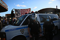 NEW YORK, NEW YORK - MAY 31: NYPD officers stand guard as People take part during a protest outside the Barclays Center in Brooklyn on May 31, 2020 in New York. Protests spread across the country in at least 30 cities in the United States. USA For the death of unarmed black man George Floyd at the hands of a police officer, this is the latest death in a series of police deaths of black Americans (Photo by Pablo Monsalve / VIEWpress via Getty Images)
