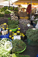 Market in Alacati selling herbs and French lavender labelled as 'wild mint', Turkey