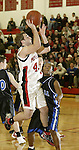 SOUTHBURY, CT, 01/02/08- 010208BZ13- Pomperaug's Bryan Wrabel (41) gets fouled by Bunnell's Chris Rosario (12) on his way to a three point play during their game at Pomperaug High School in Southbury Wednesday night.<br /> Jamison C. Bazinet Republican-American