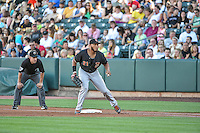 Jon Singleton (21) of the Fresno Grizzlies on defense against the Salt Lake Bees in Pacific Coast League action at Smith's Ballpark on June 13, 2015 in Salt Lake City, Utah.  (Stephen Smith/Four Seam Images)