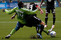 Jhon Kennedy Hurtado (34) of the Seattle Sounders fights for the ball with Chris Pontius (13) of DC United in the match played on June 17, 2009 at Quest Field in Seattle, WA. The Sounders and United played to a 3-3 draw.