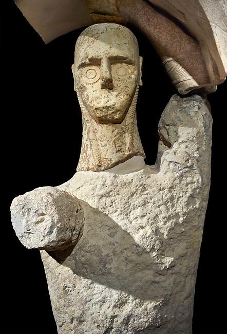 9th century BC Giants of Mont'e Prama  Nuragic stone statue of a boxer, Mont'e Prama archaeological site, Cabras. 2014 excavation. Civico Museo Archeologico Giovanni Marongiu - Cabras, Sardinia. Black background