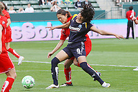 Homare Sawa #10 of the Washington Freedom takes hold of Han Duan #9 of the Los Angeles Sol to win control of a loose ball during their inaugural match at Home Depot Center on March 29, 2009 in Carson, California.