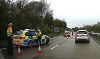 Pictured: Police and traffic officers on the A4232 near Cardiff, Wales, UK. Friday 28 May 2021<br /> Re: Police and traffic officers attended a road traffic accident in which a car veered off the northbound carriageway of the A4232 near junction 33 and ended up in trees at the side of the road just before mid-day near Cardiff, Wales, UK.